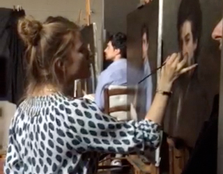 Artist DSH putting finishing touches on a portrait painting