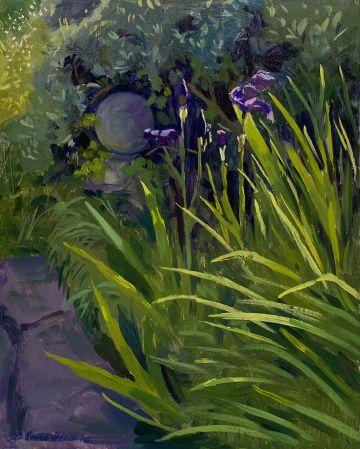 Ornamental stone amongst haloed Irises